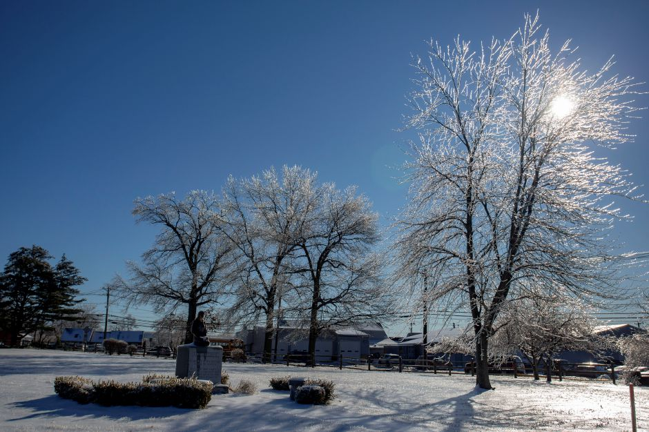 Ice glistens in the trees at Sacred Heart Cemetery in Meriden Tuesday afternoon Jan. 22, 2019. | Richie Rathsack, Record-Journal