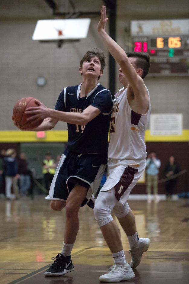 Cam Regan scored 15 points and hauled down 24 rebounds to lead Lyman Hall to a 42-37 victory over East Haven on Friday night. | Justin Weekes / Special to the Record-Journal