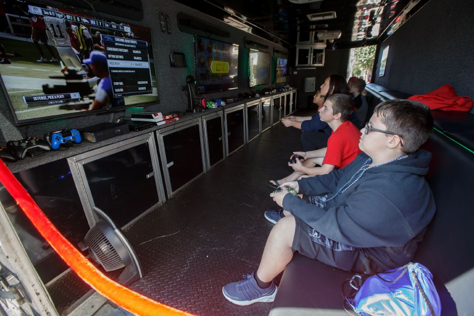 Nicholas Sineone 13 in red and brother Anthony 12 play a game in the Rolling Video Game trailer Saturday during the Southington Apple Harvest Festival in Southington September 29, 2018 | Justin Weekes / Special to the Record-Journal