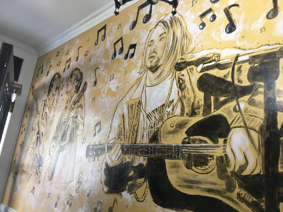 A mural by artist Paul Popolizio decorates the foyer of the Rock House School of Music in Wallingford, June 15, 2019. | Lauren Takores