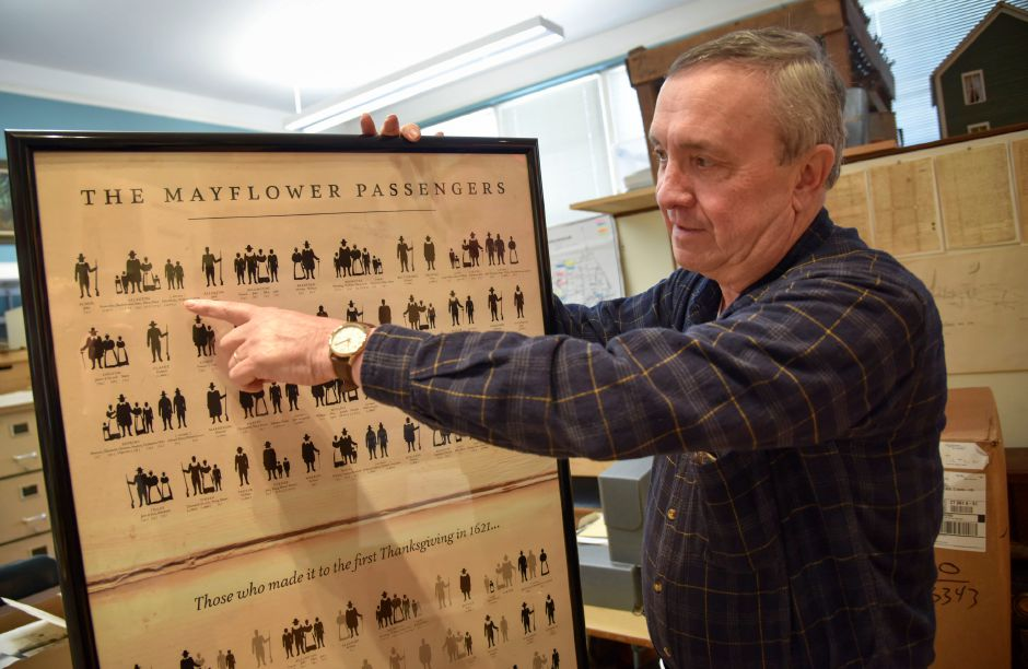 Middlefield Historical Society curator Ken Twombly points to some of his ancestors who were passengers on the Mayflower, while at the society's community center office on Wednesday.