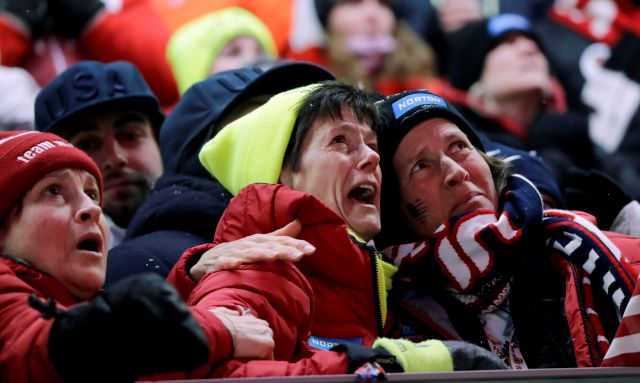 Sue Sweeney of Suffield, center, the mother of Emily Sweeney of the United States, cries out as her daughter crashes on the final run during the women
