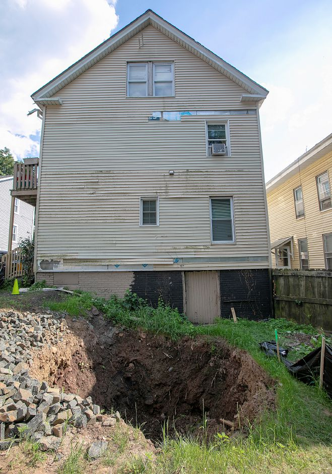 A sinkhole in the back of a house at 170 Liberty Street, Wed., July 3, 2019. Residents living in the multi-family house were moved out Wednesday by the city. Dave Zajac, Record-Journal