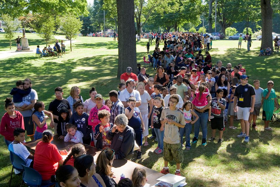 Hundreds wait to register before the start of the annual Back To School Expo at City Park in Meriden, Tuesday, August 23, 2016. | Dave Zajac, Record-Journal