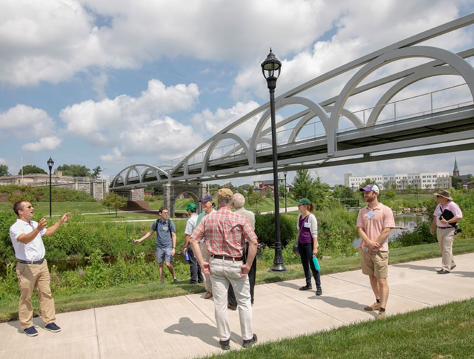 Milone & MacBroom lead landscape architect Ryan Chmielewski, left, leads members of the American Society of Landscape Architects on a tour of the Meriden Green on Wednesday. Dave Zajac, Record-Journal