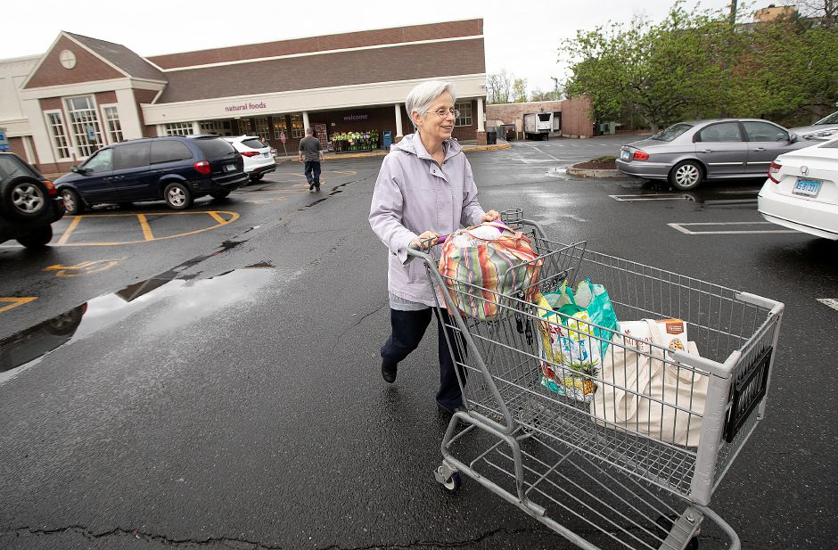 Margaret Sorenson, of Meriden, heads to her car after shopping at Stop & Shop on Broad Street in Meriden Monday. The store reopened after five unions and the company came to an agreement on contract terms Sunday evening. Photos by Dave Zajac, Record-Journal