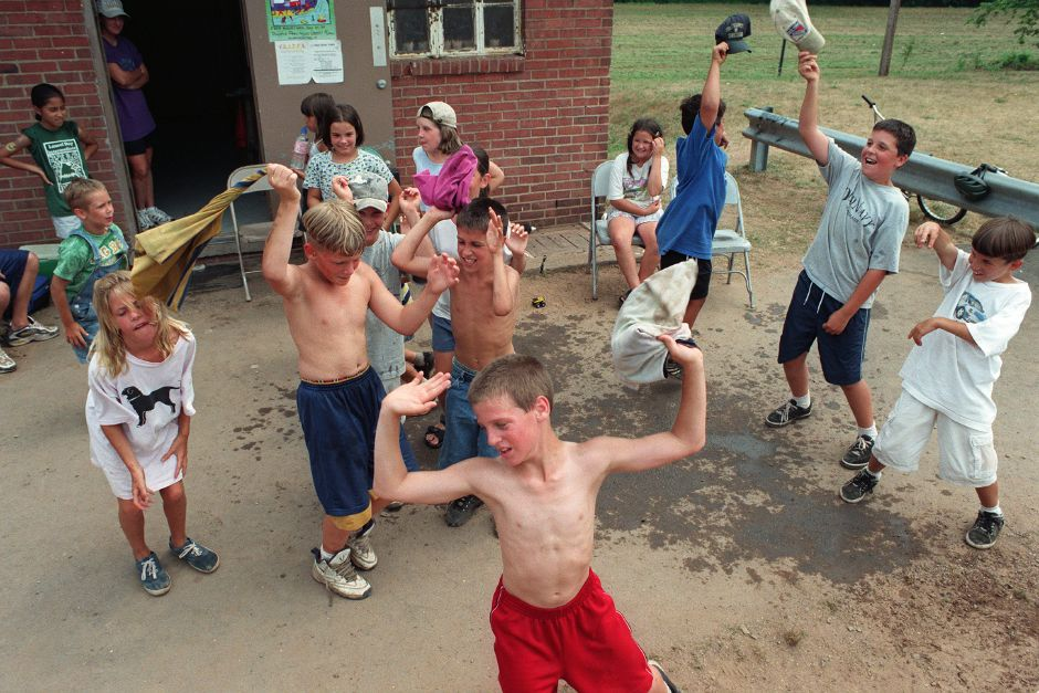 Chris Titus (front) is joined by friends showing his stuff dancing at Wallingford Parks & Rec. Dept. Summer Camp at Doolittle Park July 19, 1999. Melissa DeSandre is on the left, with Nick St. Jacques, 9, and Michael Tolokan, 10, without their shirts, and Sean Slain second from the right.