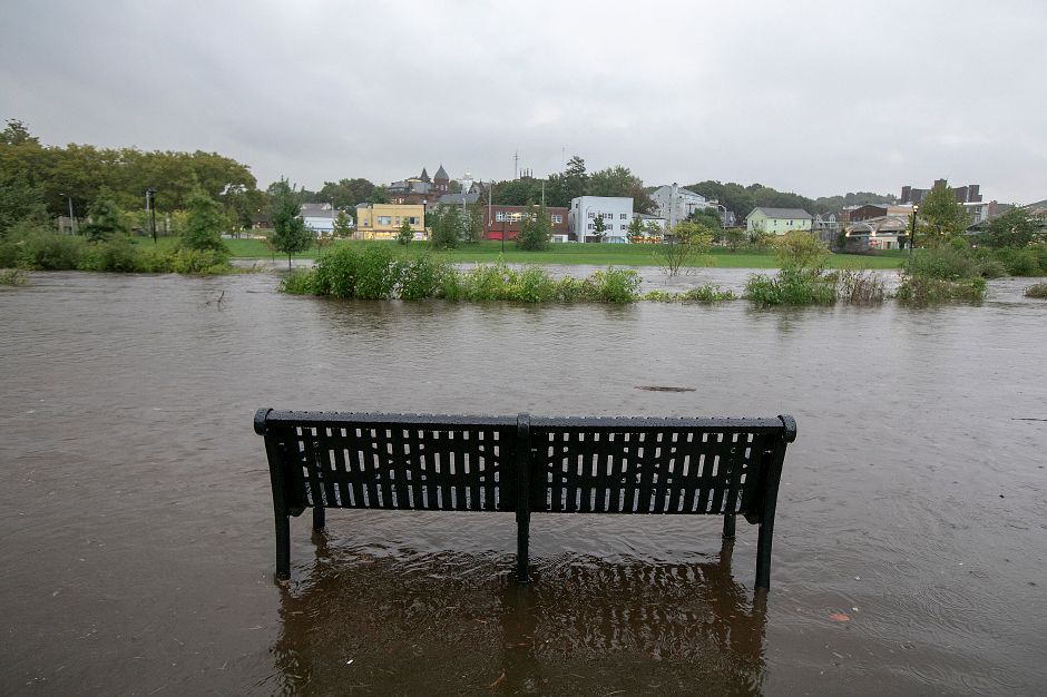 Flood waters overtake a park bench on the Meriden Green, Tuesday, Sept. 25, 2018. Heavy rain Tuesday evening closed roads and flooded basements of local homes. Dave Zajac, Record-Journal