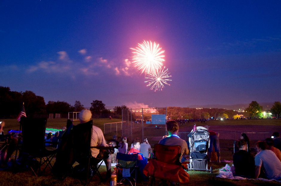 Spectators watch as fireworks light up the sky over Sheehan High School in Wallingford, July 2, 2011. (Sarah Nathan/Record-Journal)