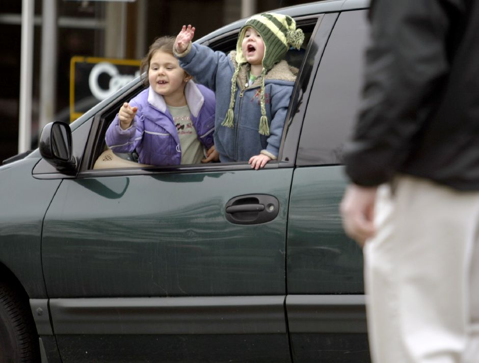 MERIDEN, Connecticut - Saturday, March 15, 2008 - Siblings Guinevere Lawson 6, left, and Quinn Lawson 2, wave from the window of a caravan as the Ancient Order of Hibernians - Division 1 - Meriden, CT pass by during the 35th Annual Meriden AOH Saint Patrick