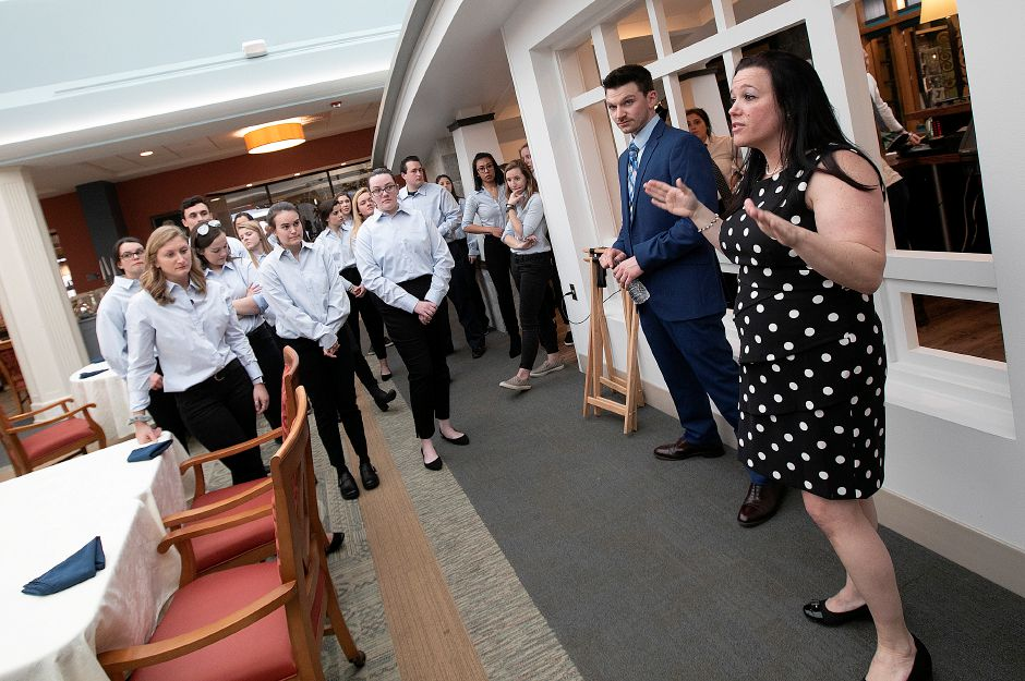 Nicole Kaya, Elim Park general manager of dining services, right, briefs waitstaff and Quinnipiac University students, left, at the start of the annual senior citizen prom for residents of Elim Park, Fri., Mar. 1, 2019. The prom was organized by members of the Student Nurses Association at Quinnipiac University. Dave Zajac, Record-Journal
