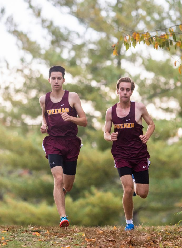 Sheehan teammates Ethan Venoit, left, and Mike Barberino push each other as they race during Tuesday's Wallingford cross country meet at Wharton Brook State Park. | Aaron Flaum, Record-Journal