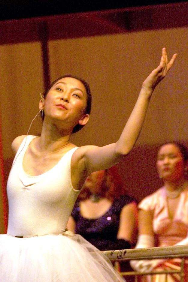 "Jien Ha, a junior (from Hong Kong) at Choate, rehearses her part in "" Grand Hotel"" during a rehearsal at the Paul Mellon Arts Center, May 1999."