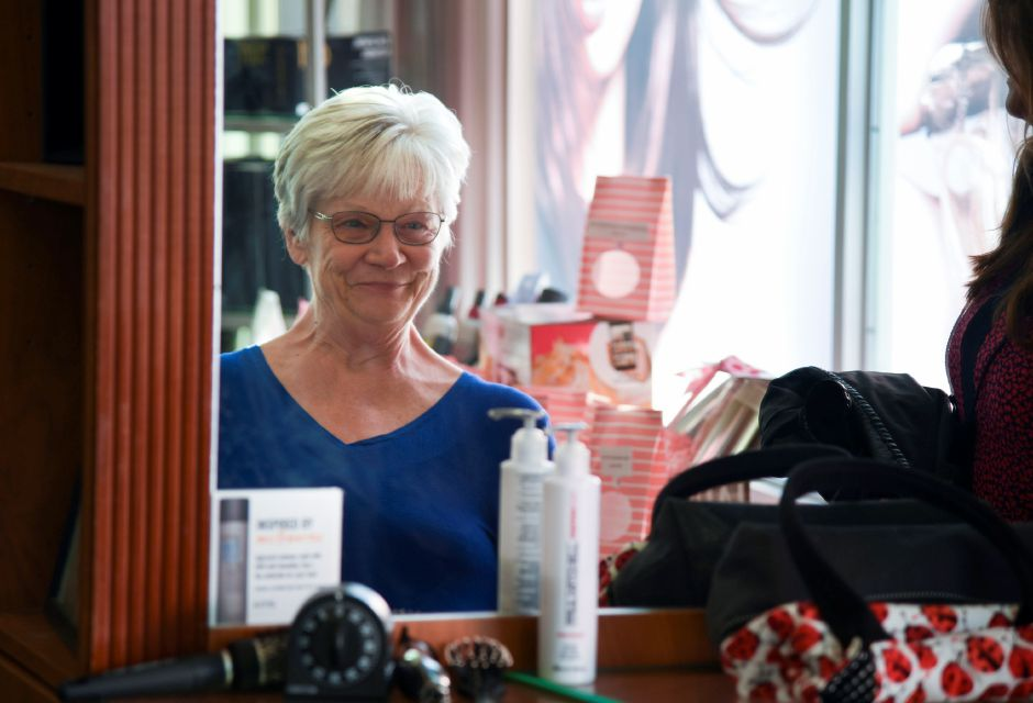 Sandy Derbacher, a breast cancer survivor from East Haven, admires her newly cut hair from North Haven salon owner Joyce-Lyn Altieri, on Wednesday, Oct. 10, 2018 at Flair for Hair. The salon is offering complimentary hair treatments for cancer survivors through the month of October and will have their 20th annual Cutting for a Cure event on Oct. 28. | Bailey Wright, Record-Journal