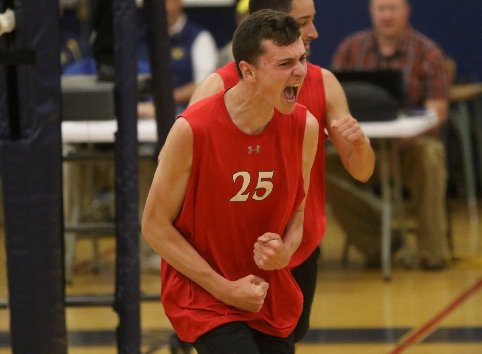 Colby Hayes is fired up after Cheshire defeated Farmington Tuesday in Waterbury to move on to the Class M volleybally finals.