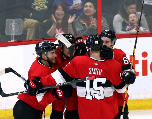 Ottawa Senators center Derick Brassard (19) celebrates his goal against the New York Rangers with defenseman Mark Borowiecki (74) right wing Mark Stone (61) and left wing Zack Smith (15) during second period NHL hockey action in Ottawa on Saturday, Feb. 17, 2018. (Fred Chartrand/The Canadian Press via AP)