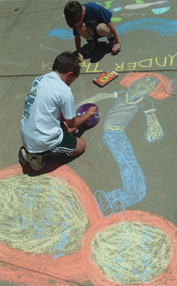Nicholas Schweers, closest, 9, and Austin Gallagi, 7, use chalk to make sidewalk art near the steps of the Wallingford Public Library Wednesday afternoon July 7, 1999. The kids are illustrating books that they are reading.