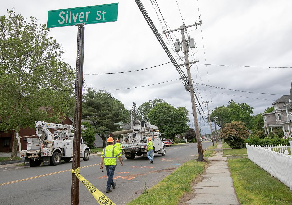 Frontier Communications workers set up to replace a utility pole damaged by a motor vehicle on Broad Street near Silver Street in Meriden, Mon., June 10, 2019. Silver Street to Ann Street is closed to traffic after police said a car crashed into a pole and the driver attempted to flee the scene. Dave Zajac, Record-Journal
