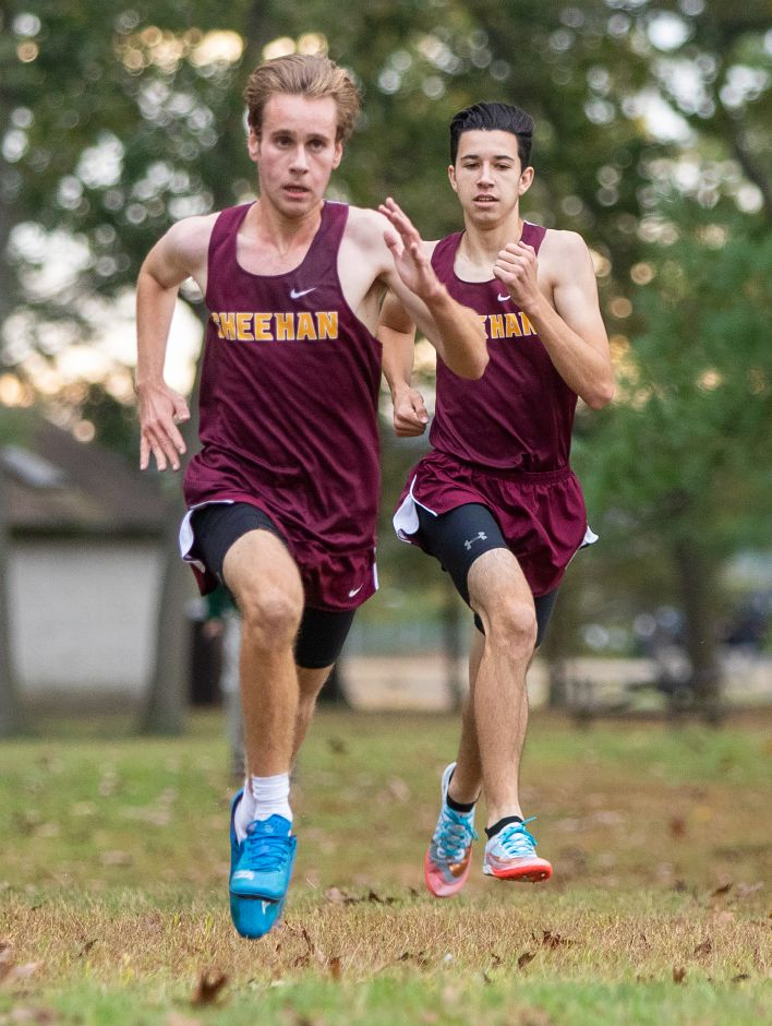Running on Air: Sheehan's Mike Barberino left and teammate Ethan Venoit sprint to the finish line during Tuesday's Wallingford cross country meet at Wharton Brook State Park. Barberino (16:54) and Venoit (16:56) finished 1-2 to lead the Titans over Lyman Hall.