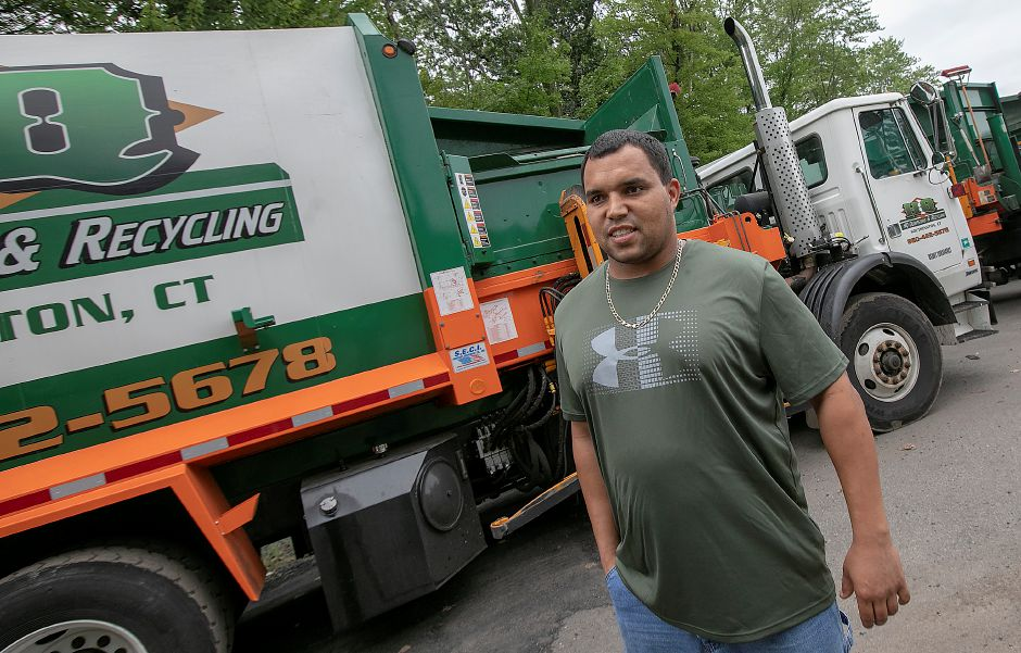 FILE PHOTO – Jack Perry, co-owner of HQ Dumpsters & Recycling, talks at the business in Southington, Tuesday, Sept. 11, 2018. Residents could see a potential increase in trash pickup fees due to new charges from the facility contracted to collect recyclables from the towns' commercial haulers. Dave Zajac, Record-Journal
