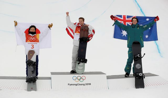 From left; Silver medal winner Ayumu Hirano, of Japan, gold medal winner Shaun White, of the United States, and bronze medal winner Scotty James, of Australia, celebrate after the men
