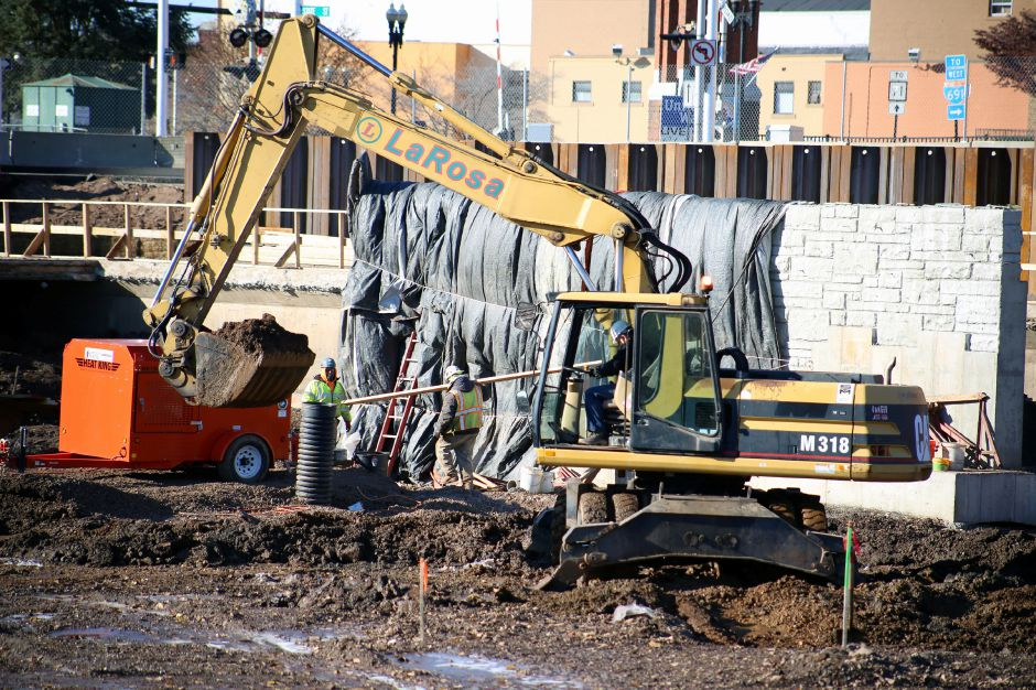 Construction work continues in the southwest corner of the Meriden hub Wednesday Nov. 19, 2014. Crews built up the area where Harbor Brook will flow under East Main Street. | Richie Rathsack/Record-Journal