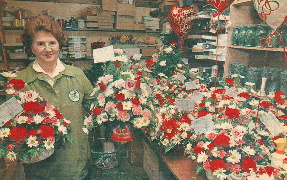Ann Greco, owner of Wallingford Flower and Gift Shoppe, displays some of the flower arrangements the shop prepared for Valentine's Day in 1992. Greco, who still works at the shop, turned 92 on Friday, Oct. 5, 2018. | Record-Journal file photo