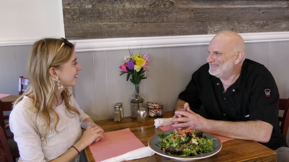 Left: Record-Journal digital content producer Ashley Kus talks Wednesday with Henry Pellerin, owner of Henry's, at 337 N Colony St. in Wallingford. Right: Fried Oreos are one of the more popular items on the restaurant's menu. Photos by Ashley Kus, Record-Journal