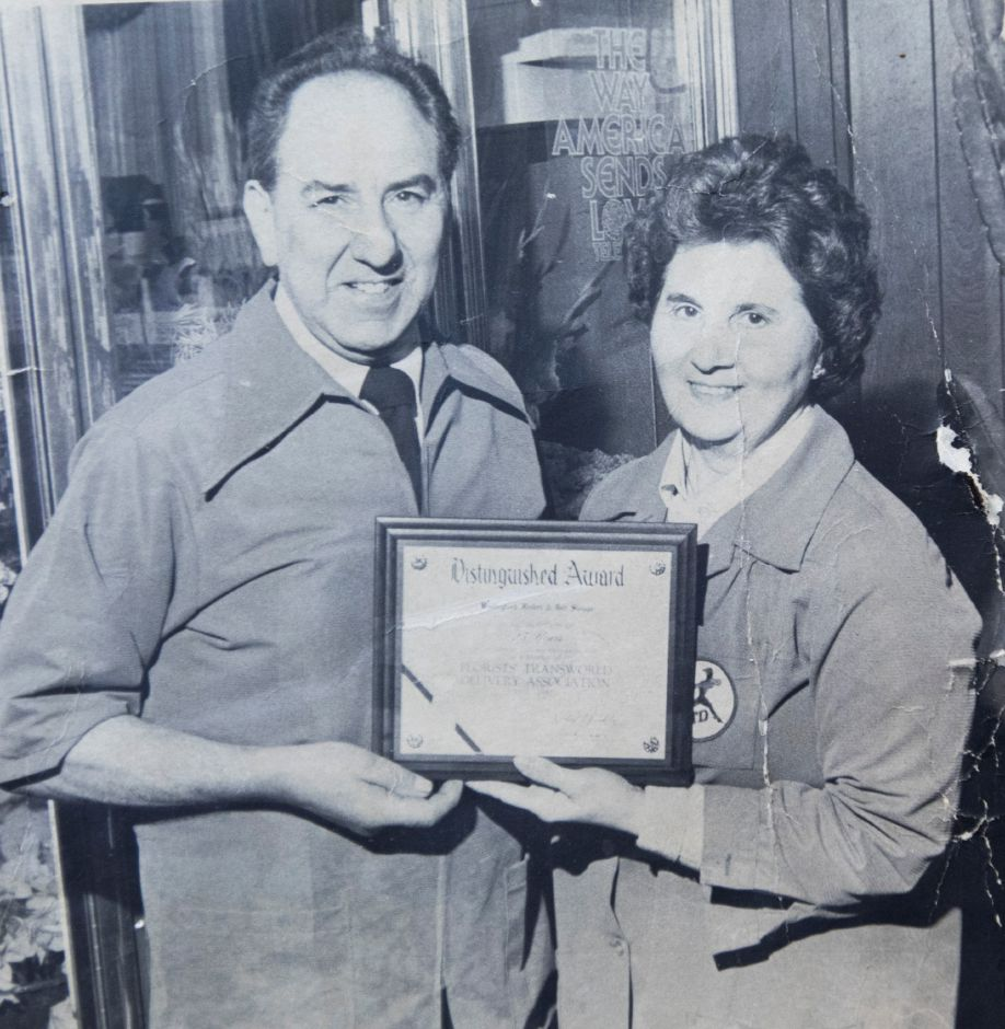 Sal and Ann Greco, owners of Wallingford Flower and Gift Shoppe, hold an award in 1960. File photo Record-Journal