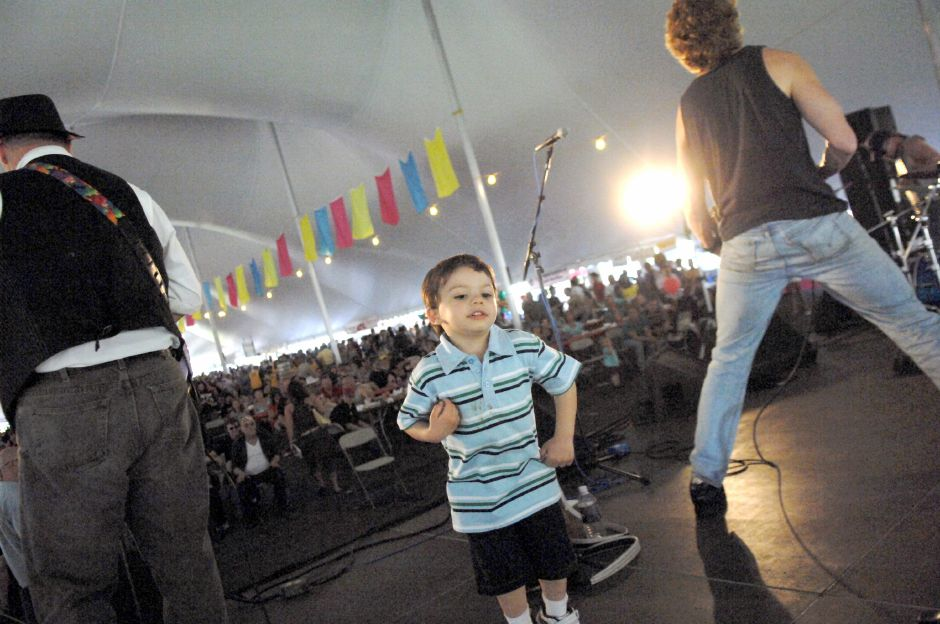 MERIDEN, Connecticut - Saturday, April 25, 2009 - Jaidyn Flematti 3, dances and plays the air guitar up on the stage with River City Slim & The Zydeco Hogs at the Food Tent Stage at the 31st Annual Daffodil Festival at Hubbard Park on Saturday, April 25, 2009. Rob Beecher / Record-Journal