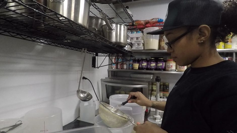 Cheyenne Rogers, chef, strains a cereal and milk ice cream base at  Milkcraft, 280 Crown St., New Haven. |Ashley Kus, Record-Journal