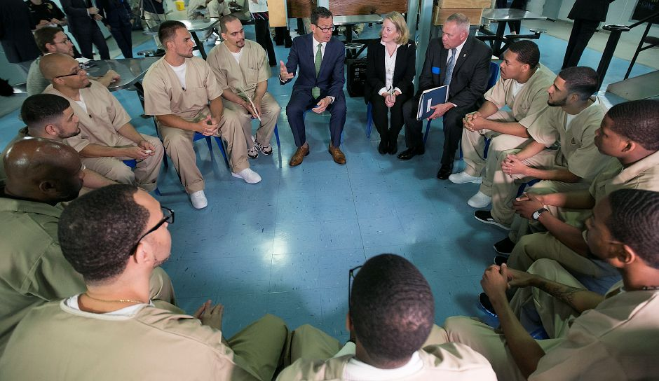 Governor Dannel P. Malloy talks next to wife Cathy Malloy and Correction Commissioner Scott Semple, during a group discussion with inmates at the Cheshire Correctional Facility, Wednesday, May 30, 2018. Dave Zajac, Record-Journal