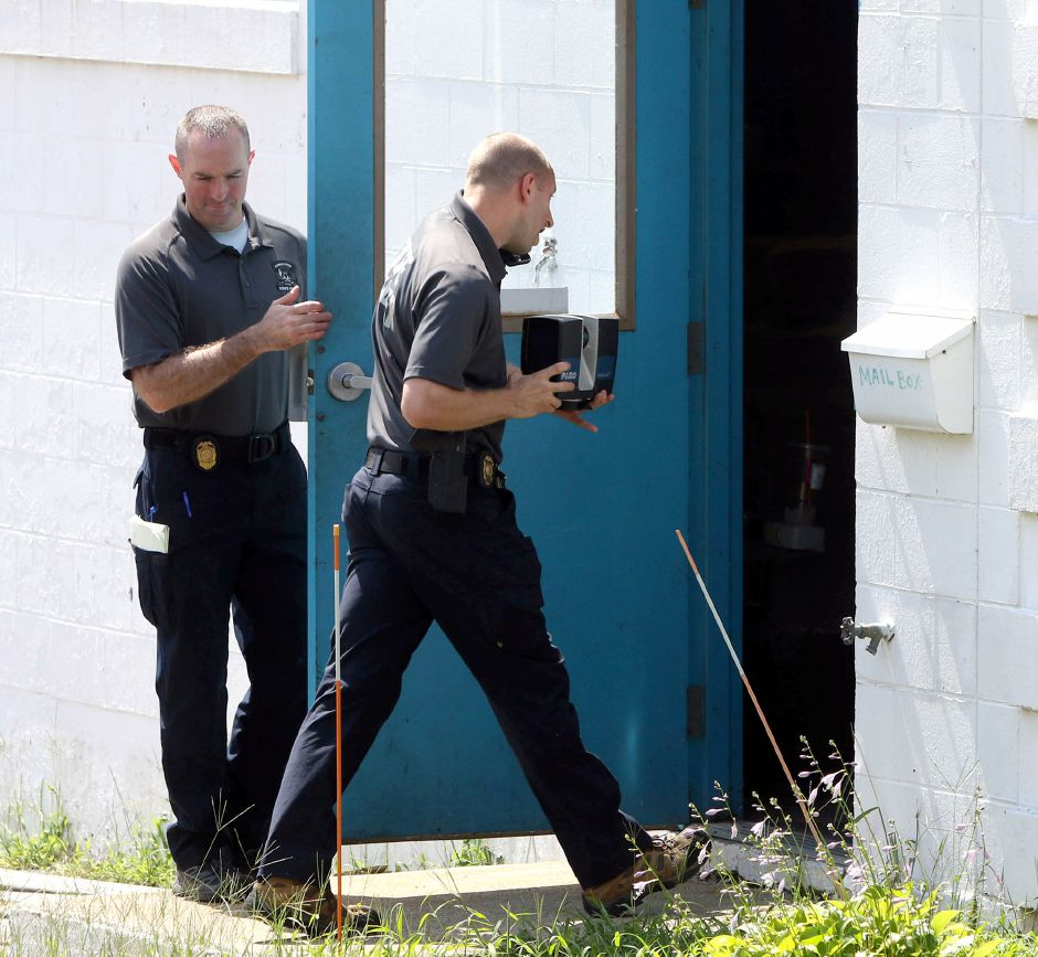 An investagator from the Connecticut State Police Major Crime squad uses a 360 degree camera to record the scene at a warehouse at 137 Brookside Road in Waterbury Thursday August 21, 2109. Police found human remains at the site which may be connected to the dissapearance of Perrie Masson 31, a missing person from Meriden. Aaron Flaum, Record-Journal