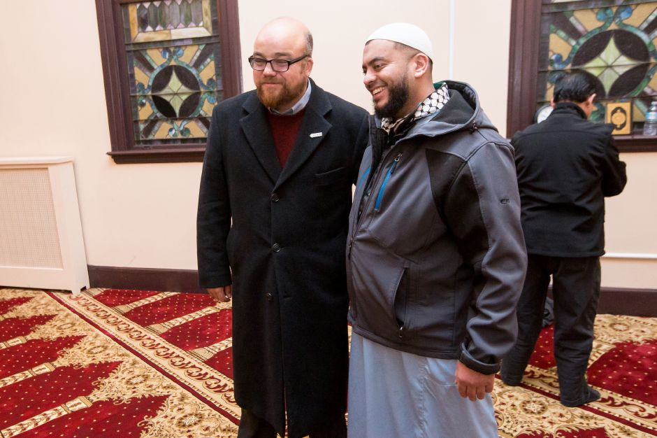 Tark Aovadi of Florida left and Fahd Syed of Waterbury pose for a picture after prayer Saturday during a community dinner celebrating the opening of the Islamic Center of Wallingford in Wallingford January 19, 2019 | Justin Weekes / Special to the Record-Journal