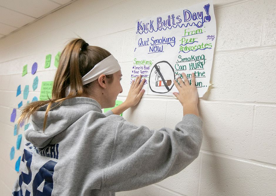 Eighth-grade student Adriana Palmieri, 14, posts an anti-smoking sign in the hall at DePaolo Middle School in Southington, Wed., Mar. 20, 2019. Students participated in National Kick Butt Day, a nationwide campaign that spreads awareness of the dangers of tobacco use. Dave Zajac, Record-Journal