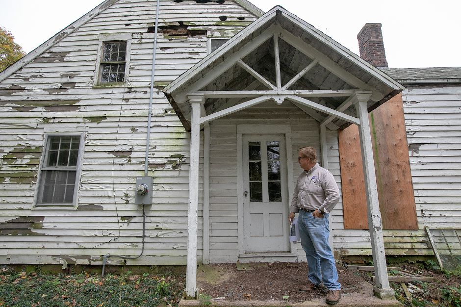 Local developer John Ricci looks over the exterior of the Nathaniel Ives house at 257 Fenn Rd. in Cheshire, Monday, Oct. 8, 2018. Ricci is owner of the house built around 1749 and is considering how to develop the 50-acre property. Dave Zajac, Record-Journal