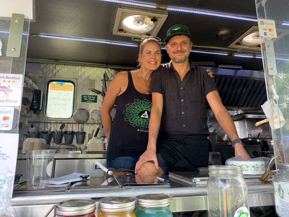 Ami Beach (left) and Mark Shadle (right), owners of Gmonkey food truck. The truck stopped by the Durham Farmers Market on Thursday, Aug. 22. Photo by Everett Bishop, Town Times.