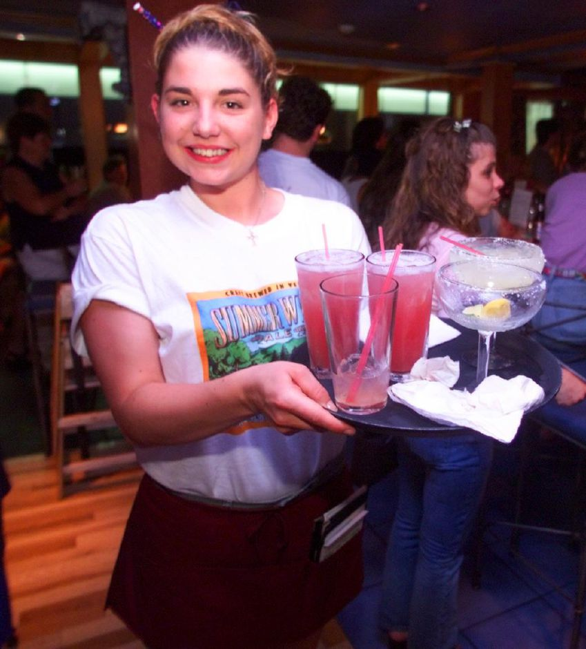 Waitress Megan Hayes with a tray full of goodies at Sabbatical
