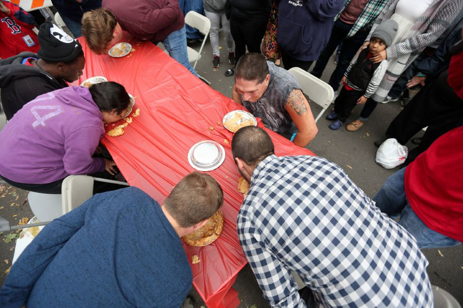 Contestants compete in an apple pie eating contest in front of the main stage at the annual Apple Harvest Festival in Southington on Saturday, Oct. 12, 2019. Emily J. Tilley, special to the Record-Journal.