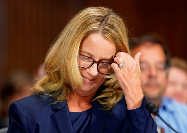 Christine Blasey Ford arrives to testify before the Senate Judiciary Committee on Capitol Hill in Washington, Thursday, Sept. 27, 2018. (AP Photo/Andrew Harnik, Pool)