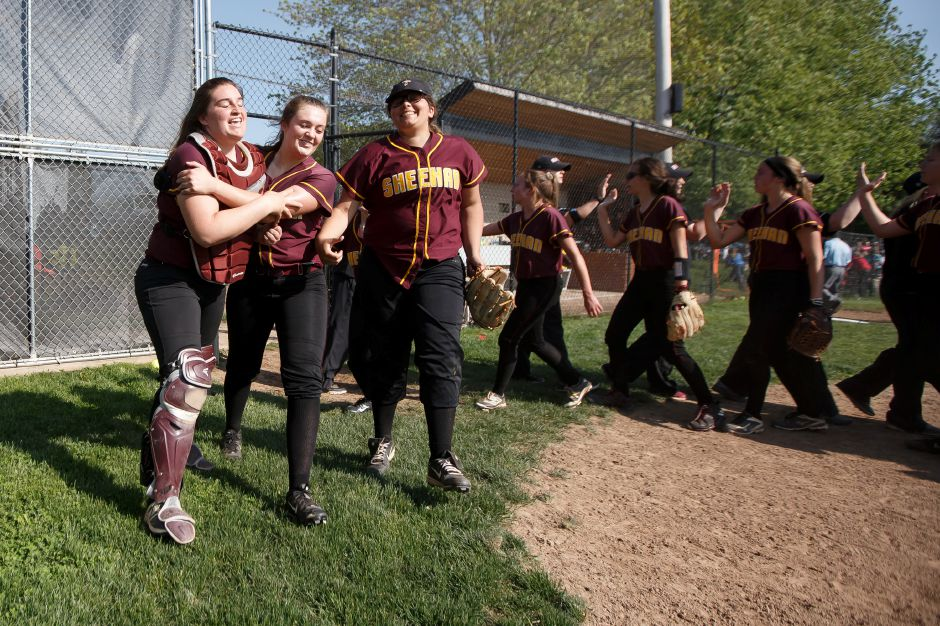 Sheehan's Carolyn Biel, left, Sydney Hunt and Marissa Gonzalez celebrate after defeating Cheshire 3-2 on Wednesday in the quarterfinal round of the SCC tournament at Cheshire High School.  Photos by Justin Weekes, special to the Record-Journal
