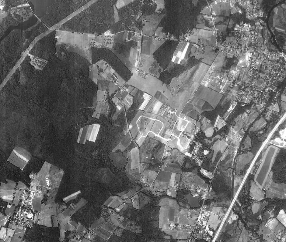The first streets of what would become The Ridges take shape in an aerial photo of Yalesville, circa 1951. Ridgeland Circle can be seen in the center. | University of Connecticut Library Map and Geographic Information Center