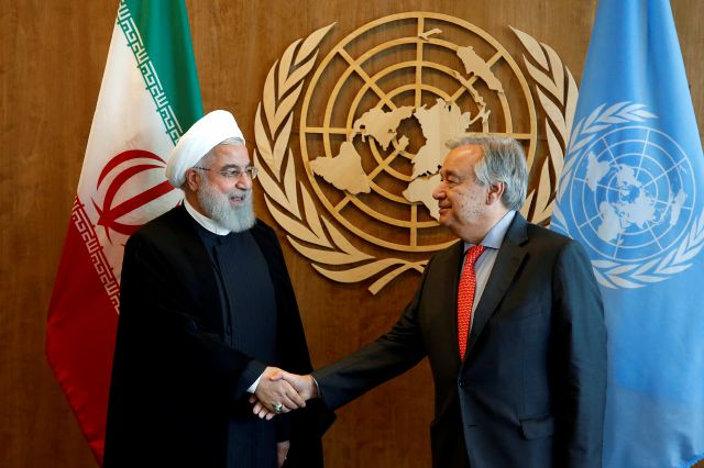 Iranian President Hassan Rouhani, left, meets with United Nations Secretary General Antonio Guterres on the sidelines of the 73rd session of the United Nations General Assembly, at U.N. headquarters, Wednesday, Sept. 26, 2018. (AP Photo/Jason DeCrow)
