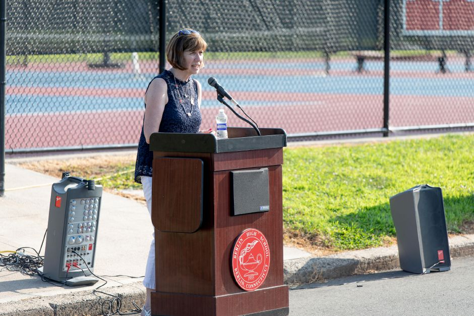 Berlin High School Teacher Eileen Thurston speaks at the dedication ceremony of the Berlin High School tennis courts on August 8 ,2019. The courts were named after former coach Rex Smith, who passed away in November 2018. | Devin Leith-Yessian/Berlin Citizen