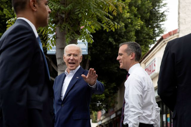 Former vice president and Democratic presidential candidate Joe Biden, left, waves toward members of the media as he and Los Angeles Mayor Eric Garcetti leave King Taco after talking to patrons Wednesday, May 8, 2019, in Los Angeles. (AP Photo/Jae C. Hong)