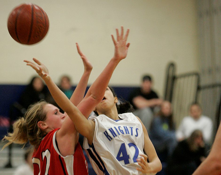 Record-Journal Photo/ Johnathon Henninger 12.29.2008 - Emily Thomas, a Cheshire Ram defends against Southington Lady Knight, Mariah Berry at the Holiday Classic at Southington High School Monday night.