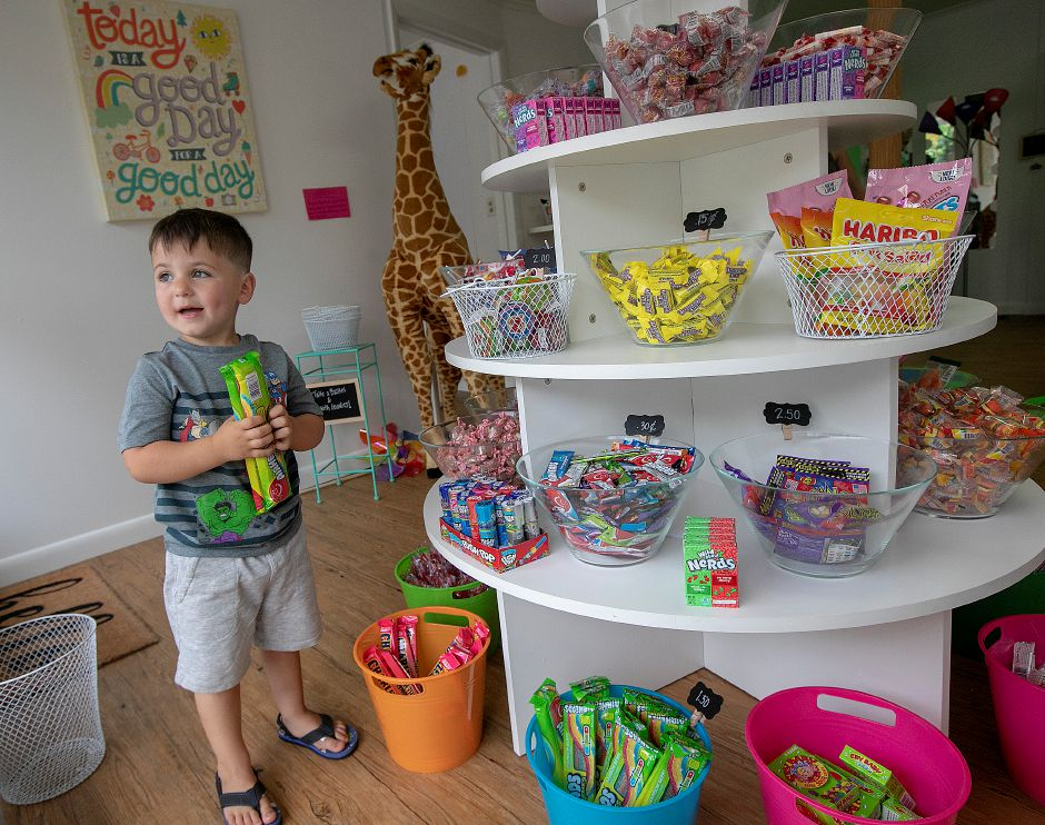 Left: Joey Calvanese, 3, of Southington, shops for candy Wednesday at Frootie Tooties Candy & More, 88 Center St. in Southington. Right: A variety of candy.Dave Zajac, Record-Journal