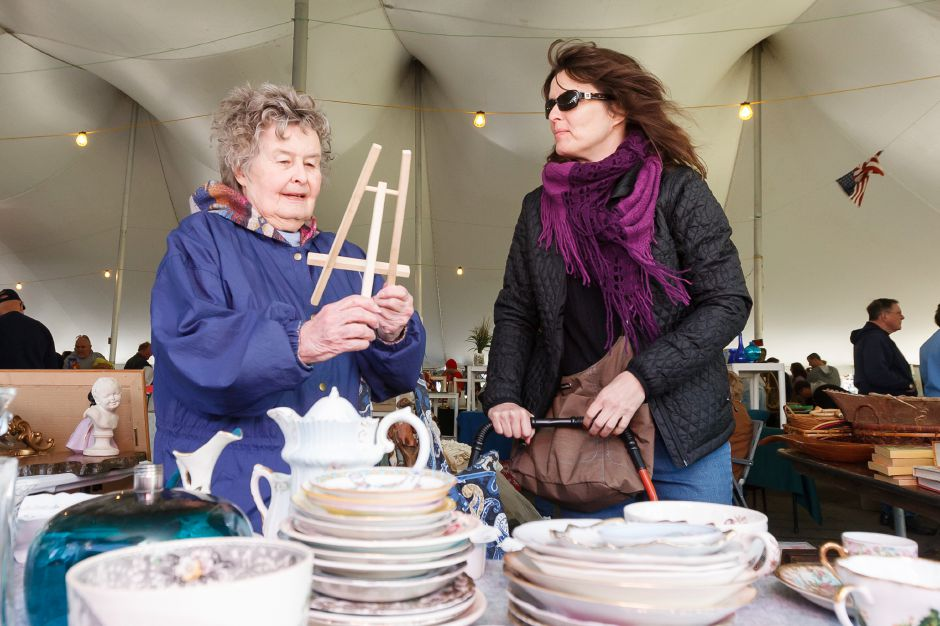 Lorraine left and Diane Asmus of North Haven decide to buy a small picture stand Saturday during the Daffodil Tag Sale in Hubbard Park Meriden August,5 2013 | Justin Weekes / For the Record-Journal