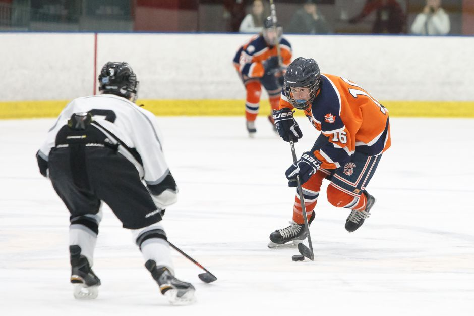 Lyman Hall's Aidan Weir forced overtime in Thursday night's season opener against North Haven with a goal scored with just five seconds left in regulation. The Trojans went on to win the SCC/SWC crossover at Northford Ice Pavilion 5-4 in overtime. | Justin Weekes / Special to the Record-Journal