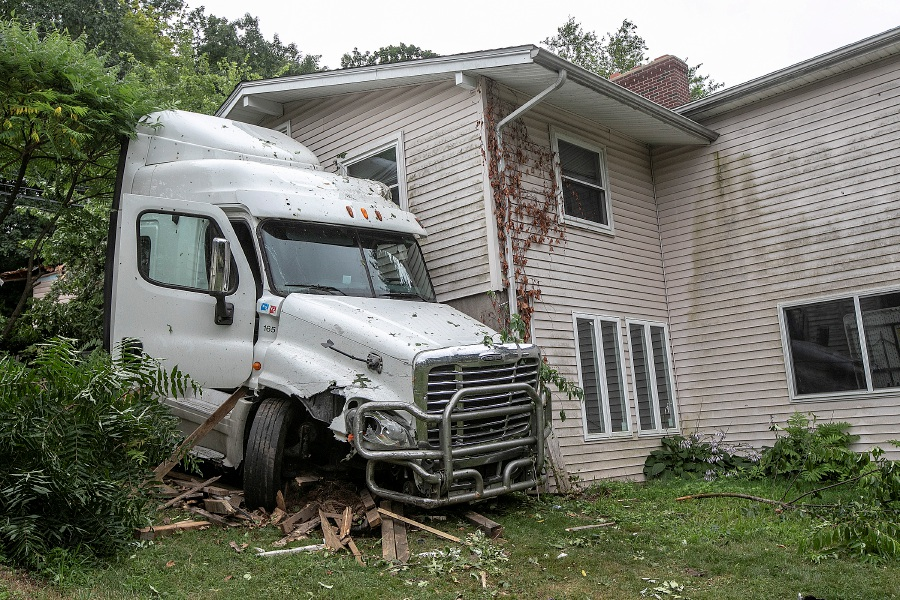 A tractor-trailer carrying mail crashed into a home at 484 Preston Ave. in Meriden on Thursday.Dave Zajac, Record-Journal